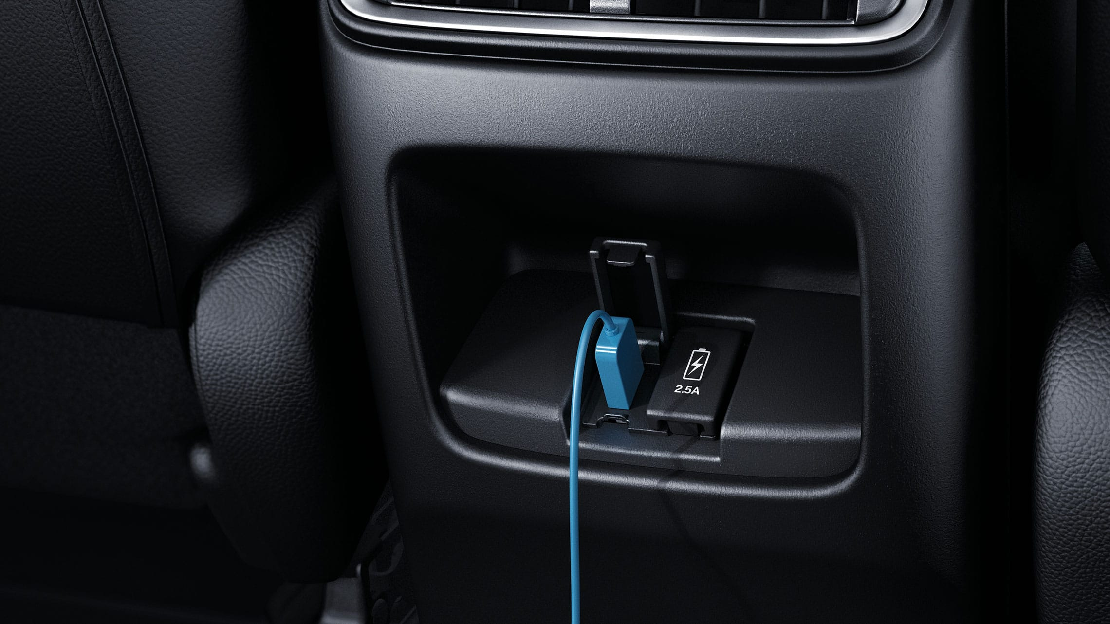 Interior view of rear USB ports in the 2020 Honda CR-V.