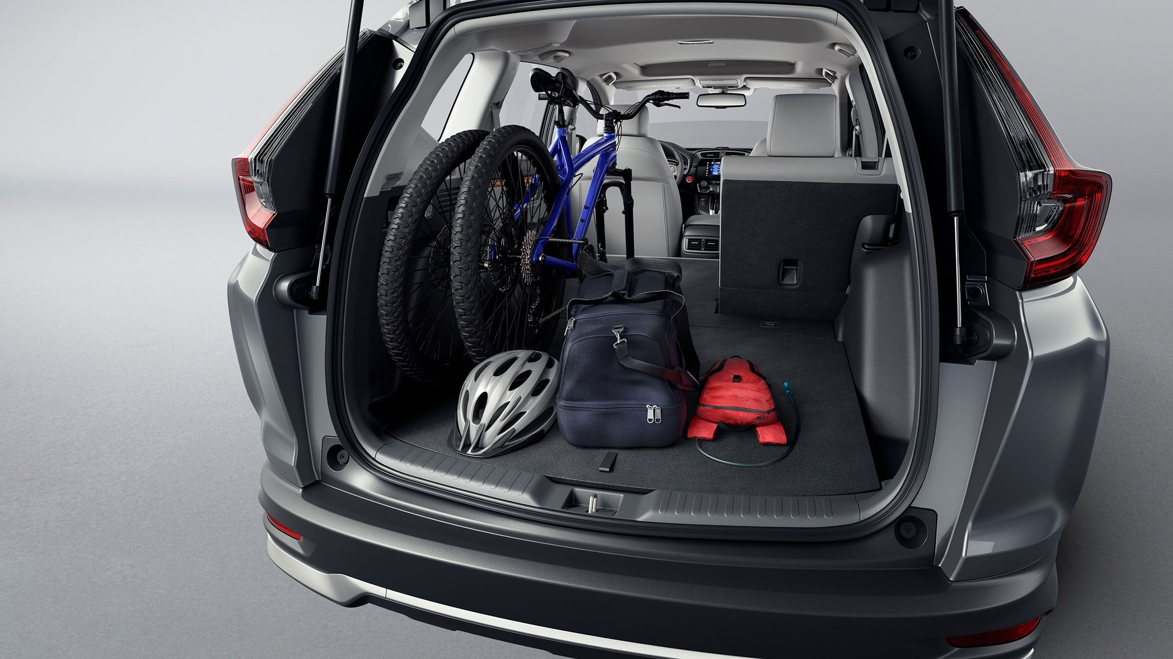 Rear view of 2020 Honda CR-V Touring in Modern Steel Metallic demonstrating cargo space.