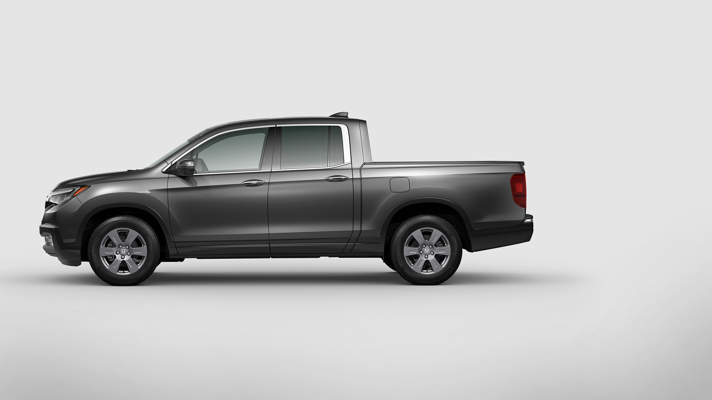Driver-side profile view of  the 2020 Honda Ridgeline RTL-E in Modern Steel Metallic.